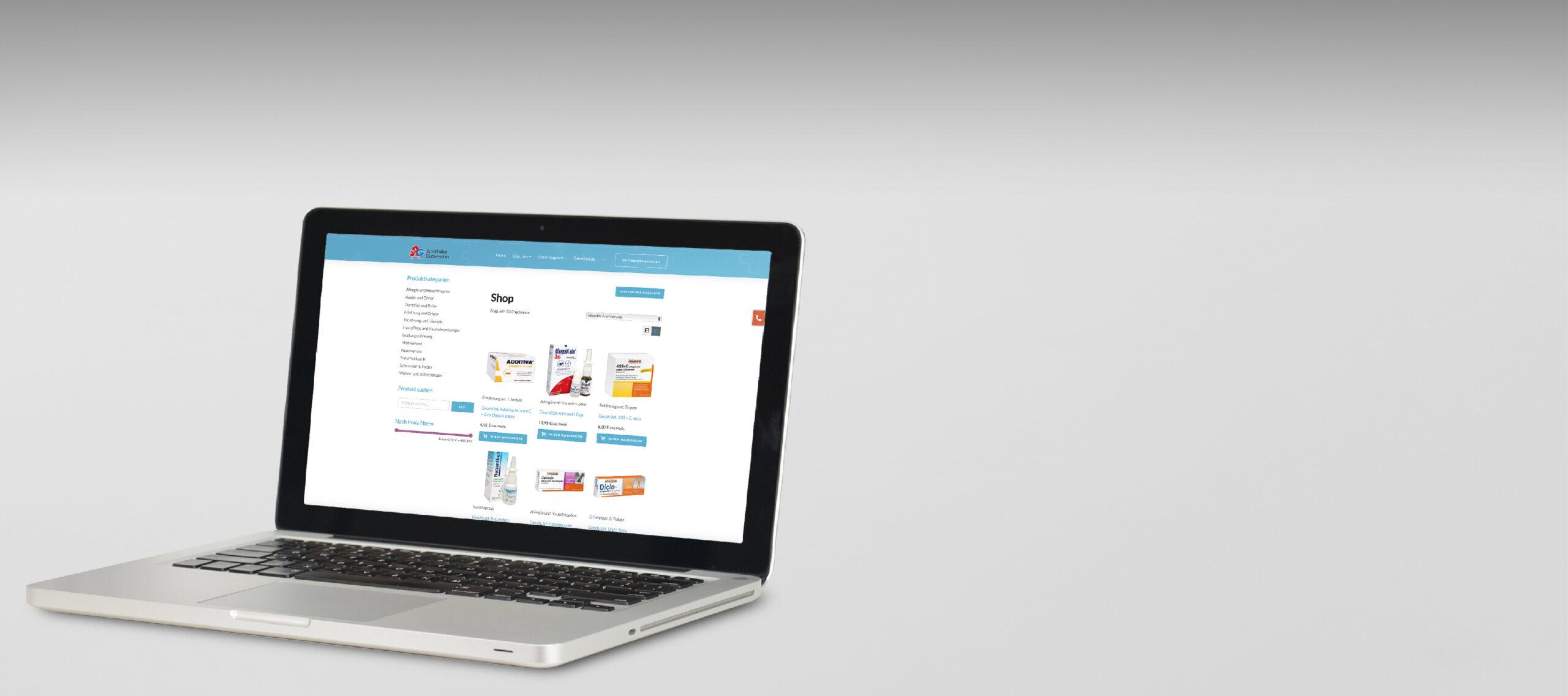 Header der ein MacBook mit einem Apotheken Online-Shop zeigt